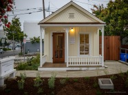 The charm of the historic Shotgun House is evident, even before it is ensconced in greenery.